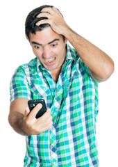Desperate angry man looking at his mobile phone