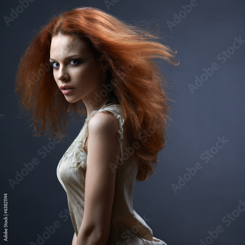 beautiful red-haired girl in the dark