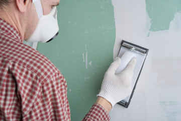 Sanding the drywall mud