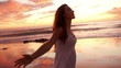 Teenage girl dancing on the beach during magical sunset