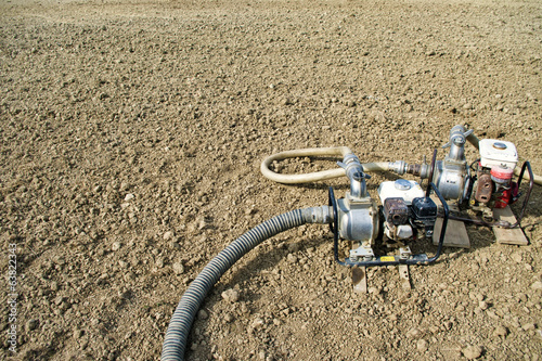 Water pumps on dry agriculture field