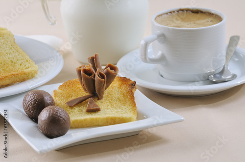 Breakfast with coffee, toasts, and chocolate