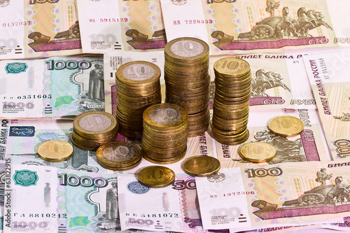 Stack of coins on banknotes background