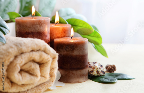 relaxing spa with candles and towels