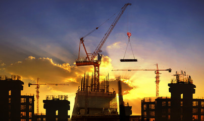 big crane and building construction against beautiful dusky sky