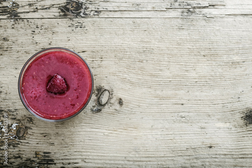 Raspberry Smoothie on rustic wooden background