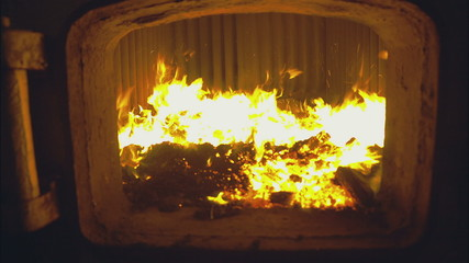 The flame in the furnace coal boiler