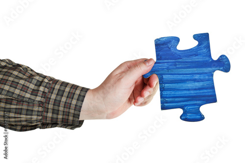 male hand with painted blue puzzle piece