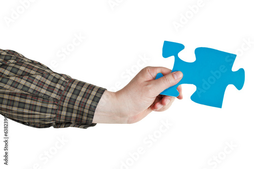 male hand holding big blue paper puzzle piece