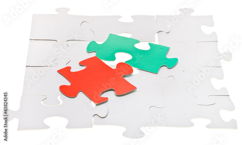 red and green pieces on assembled white puzzles