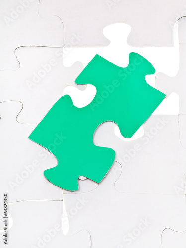 green piece on free space of assembled puzzles