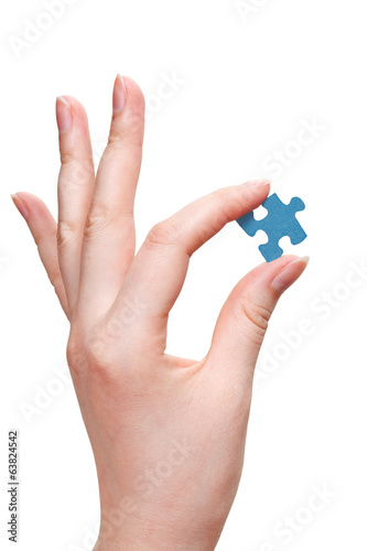 female arm holding puzzle piece
