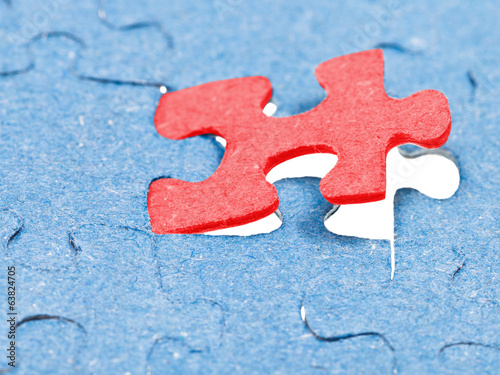 setting the last red piece of puzzle