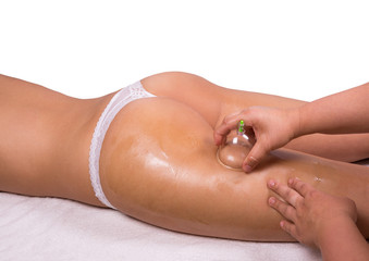 Caucasian female laying and get a cupping therapy
