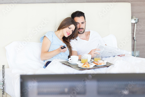 Couple Watching TV at Hotel Room