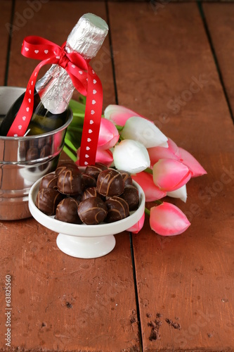romantic still life champagne, flowers tulips, chocolate
