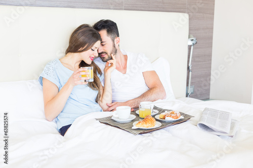 Couple Having Breakfast at Hotel Bedroom