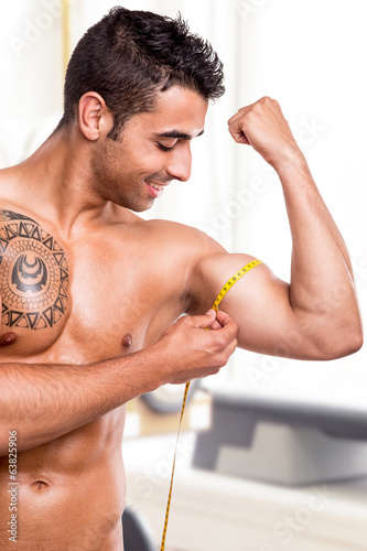 Fitness man measuring body