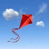 Roter Flugdrachen vor blauem Himmel