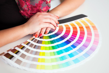 Graphic designer working with cmyk palette