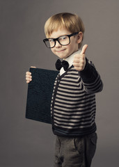 boy little smart child in glasses showing blank card certificate