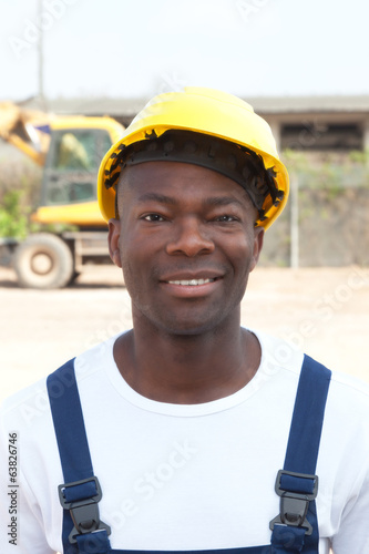 Portrait of an african worker at construction site