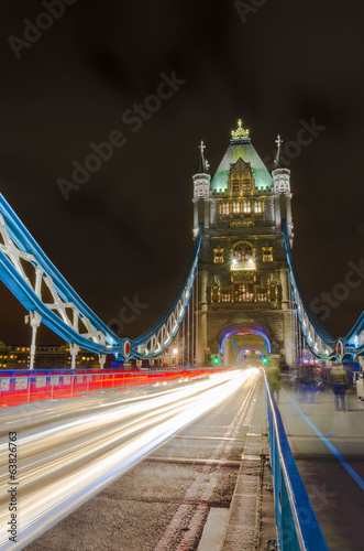 Tower Bridge at night with moving light traces, London, Uk