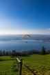 Paraglider over the Zug city, Zugersee and Swiss Alps during a s