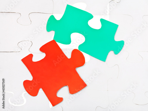 red and green pieces on assembled puzzles