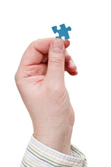men hand in shirt holding jigsaw puzzle piece