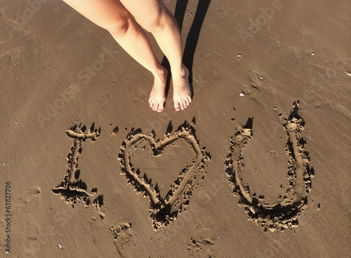 Love message in the sand of the beach