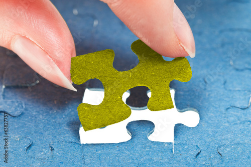inserting the last piece of puzzle