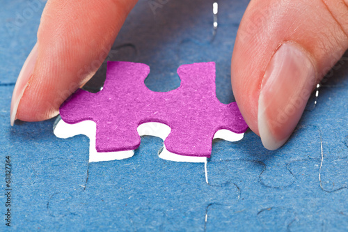inserting the last pink piece of puzzle