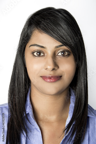 Closeup Indian Woman smiling in work clothes