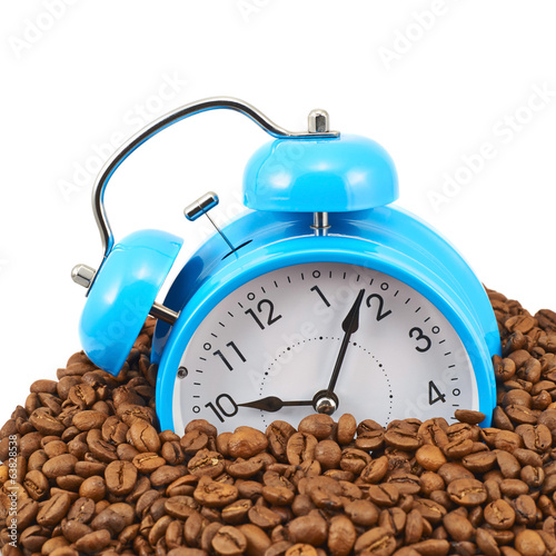 Blue alarm clock buried in beans