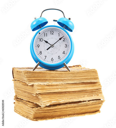 Alarm clock on the stack of books