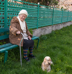 Senior woman sitting on a bench