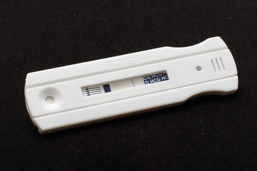 Negative pregnancy test on the black background