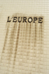 The french word Europe in characters on a tiled wall