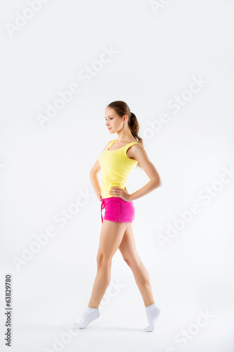 young athletic girl warming up