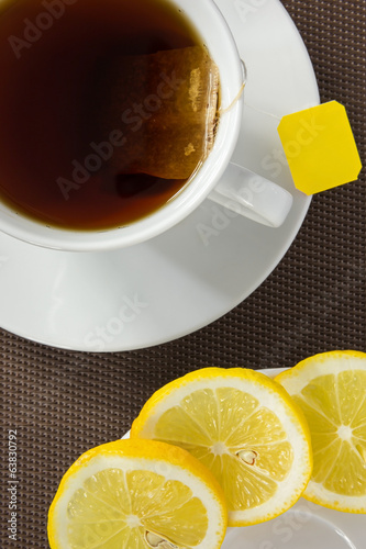 Tea cup and slice of lemon