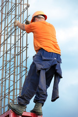 Construction worker during mounting concrete formwork