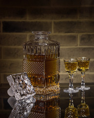 Crystal decanter of whisky and two glasses