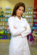 Confident and serious female pharmacist stnading and smiling
