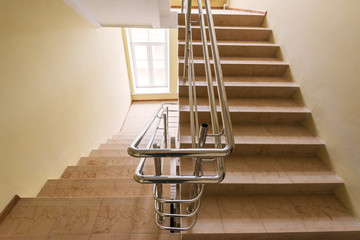 Staircase with metallic handrails