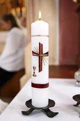 Burning candle in church