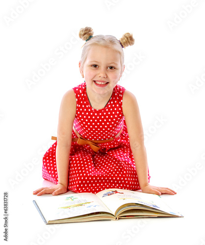 portrait of a little girl reading books, sitting on the floor
