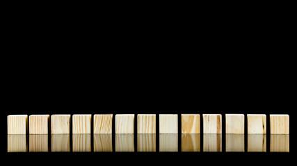 Row of thirteen wooden blocks