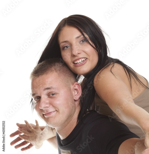 Cheerful couple having fun young smiling people embracing