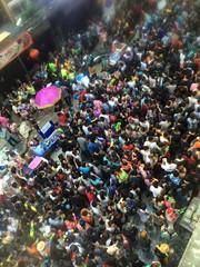 Tourists in Songkran featival at Silom road Bangkok Thailand